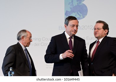 BARCELONA, SPAIN - MAY 03: Miguel Fern�¡ndez Ord�³�±ez, Mario Draghi and V�tor Const�¢ncio at the press conference following the Governing Council meeting of the ECB on May 3rd 2012 in Barcelona, Spain