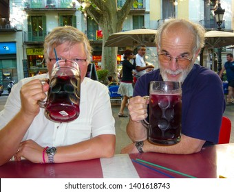 Barcelona / Spain - May 1, 2106: Giant Sangria Mugs Delight Pals on Las Ramblas in Barcelona