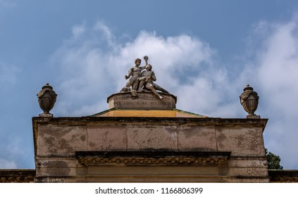 Barcelona, Spain - May 10, 2018: Sculpture representing Art and Nature on the top of pavilion of Carlos IV in Labirinth Park of Horta. The words are 'Harmony of art and nature engenders beauty'.