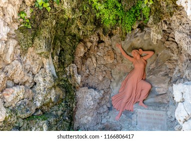 Barcelona, Spain - May 10, 2018: Relief of terracotta nymph Echo in the Grotto of Echo and Narcissus in Labyrinth Park of Horta.