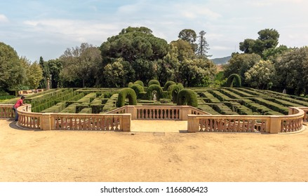 Barcelona, Spain - May 10, 2018: Panoramic view on neoclassical-style Park of Horta. The hedge maze that gives the park its name, made up of 750 metres of trimmed cypress trees.
