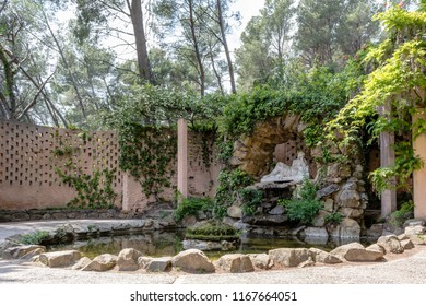 Barcelona, Spain - May 10, 2018: The grotto of the nymph Egeria - one of the naiads, inhabitants of fountains, rivers and lakes - with circular pond in Horta Labirinth Park.