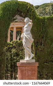 Barcelona, Spain - May 10, 2018: Statue of Eros, the Greek god of love, in the center of Labyrinth Park of Horta. Made of marble, it measures 1.40 m high and currently has mutilated arms.