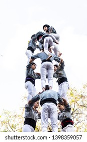 BARCELONA, SPAIN - MAY 11, 2019: Castellers group of people that build human castles on May 11, 2019 in Barcelona. Castles is a Human Tower traditional festivities in Catalonia Spain.