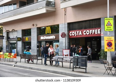 Barcelona, Spain - May 13, 2018:  Costa Coffee, the British coffeehouse that is the second largest coffeehouse chain in the world, and a McDonalds across from the Sagrada Familia.