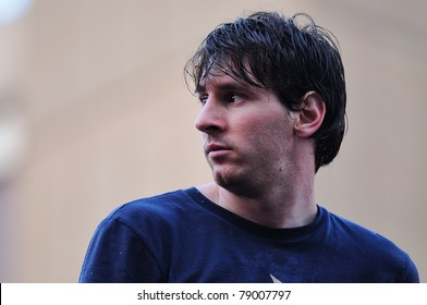 BARCELONA, SPAIN - MAY 13: Lionel Messi, F.C Barcelona player, celebrates Spanish League victory with thousand of fans in the streets on May 13, 2011 in Barcelona, Spain.