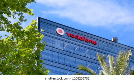 Barcelona, Spain - May 15, 2018: Vodafone sign on a building. Vodafone Group is a British telecommunications company headquartered in London and with its registered office in Newbury, Berkshire.