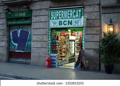 Barcelona, Spain, May 19, 2017: Exterior view of mini supermarket in the early morning when it is still a little dark outside, Barcelona