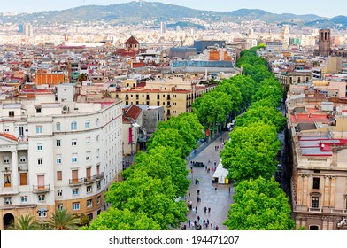 BARCELONA, SPAIN - MAY 2: Las Ramblas on May 2, 2014 in Barcelona.Thousands of people walk daily by this popular pedestrian street.