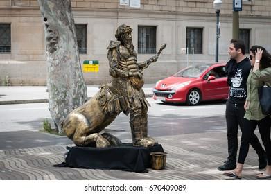 BARCELONA, SPAIN - MAY 2017: People meet live sculpture of fantasy hero at Ramla street of Barcelona town