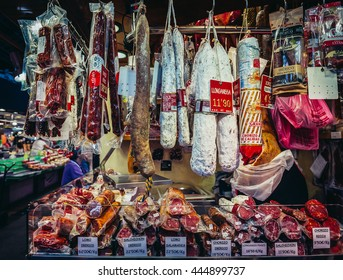 Barcelona, Spain - May 26, 2015. Traditional Longaniza sausages for sale at public market called La Boqueria, foremost tourist landmarks in Barcelona