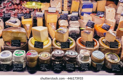 Barcelona, Spain - May 28, 2015. Cheese stand at market called La Boqueria, foremost tourist landmarks in Barcelona