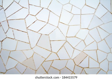 """BARCELONA, SPAIN - MAY 31, 2013: White ceramic mosaic pattern detail, designed by Antonio Gaudi and better known as """"trencadis"""". Located in the Park Guell."""