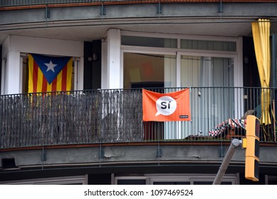 Barcelona, Spain - May 5, 2018:  Balcony with Catalonian flag and Si (Yes) poster, a reference to the controversial referendum on independence held in October of 2017.