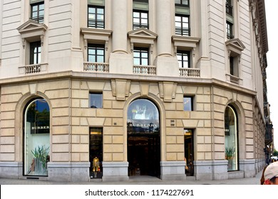 Barcelona, Spain - May 5, 2018:  British luxury fashion house, established in  1856, Burberry store on Passeig de Gràcia, a high end shopping area.