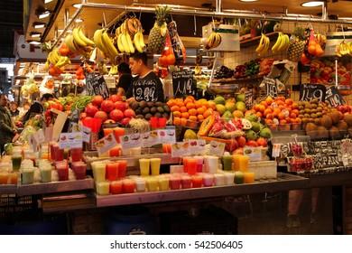 BARCELONA, SPAIN - MAY 6, 2015: Fruit seller at La Boqueria, market of Barcelona.