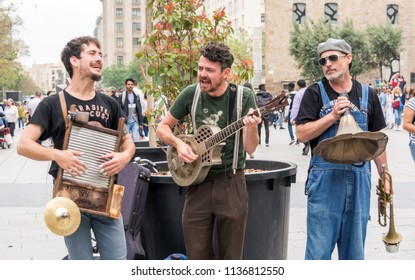 "Barcelona, Spain - May 8, 2018: ""Los Boozan Dukes"" band playing on the street in Barcelona near the Gothic Quarter on peculiar musical instruments."