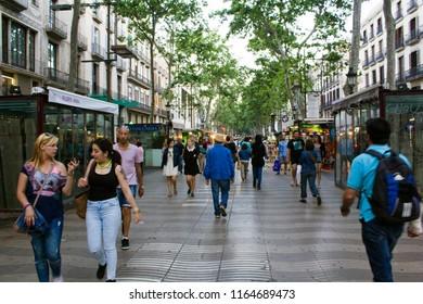 Barcelona, Spain - May, Circa 2015: People walking on the most famous avenue in barcelona Las Ramblas