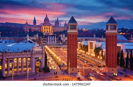 Barcelona, Spain. Nighttime top view at Spanish Square with tower and national palace art museum Catalonia far away.