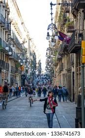 BARCELONA, SPAIN - NOV 09, 2016: La Rambla in Barcelona, Spain. La Rambla is a street in central Barcelona, between El Raval and Barri Gotic districts