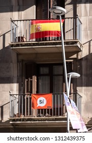 Barcelona, Spain - Nov 12, 2017: Si Yes for the referendum flag banner placard on the Barcelonian window preparing for the 2017 Catalan independence referendum