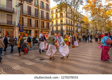 BARCELONA, SPAIN - NOV 30, 2018:  La Rambla in Barcelona, Spain. La Rambla is a street in central Barcelona, between El Raval and Barri Gotic districts