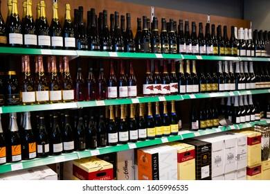 BARCELONA, SPAIN - NOVEMBER 07, 2019: Racks with cava in supermarket - traditional spanish rose and white sparkling wine