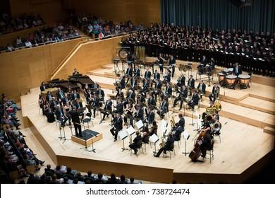 BARCELONA, SPAIN - NOVEMBER 08, 2015: Audience and orchestra at the concert Carmina Burana in music hall Auditori Banda municipal de Barcelona, Catalonia.