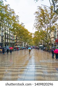 BARCELONA, SPAIN - November 09, 2018: Las Ramblas in Barcelona one morning with rain. View from the top, near the Plaza Cataluña
