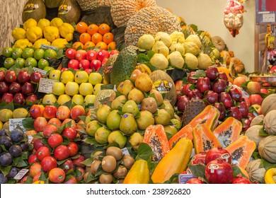 BARCELONA, SPAIN - NOVEMBER 10, 2014: Different kind of fruit at La Boqueria market,  one of the foremost tourist landmarks