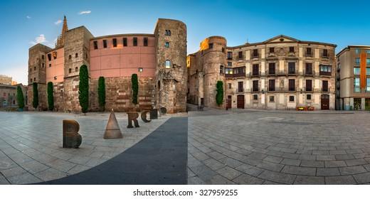 BARCELONA, SPAIN - NOVEMBER 16, 2014: Roman Gate and Placa Nova in Barri Gotic Quarter, Barcelona. Barri Gotic is the centre of the old city of Barcelona. It stretches from La Rambla to Via Laietana.
