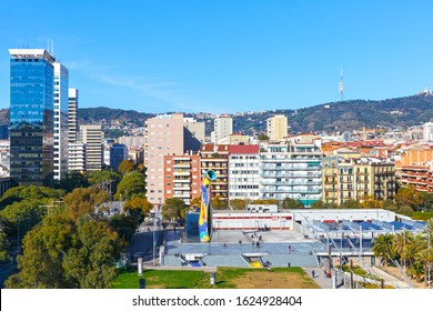 Barcelona, Spain - November 24, 2019: Joan Miro park. Town park planted with palms and pines, plus a large sculpture Woman and Bird by artist Joan Miro.