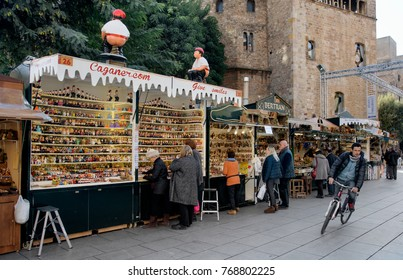 BARCELONA, SPAIN - NOVEMBER 28, 2017: A view of the stalls of the Mercat de Santa Llucia, the popular Christmas market that is installed every year in front of the Cathedral during the holiday season