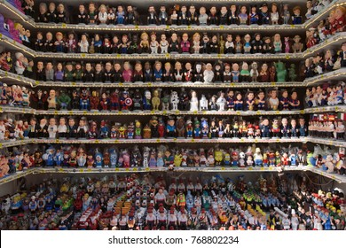 BARCELONA, SPAIN - NOVEMBER 28, 2017: Stall in the Mercat de Santa Llucia, the popular Christmas market of Barcelona, with many caganer, a typical catalan character in the nativity scenes of Catalonia