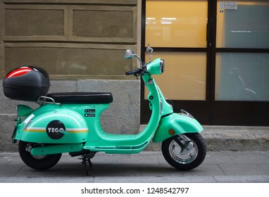 BARCELONA, SPAIN - NOVEMBER 29, 2018: Traditional italian scooter - Vespa on the sidewalk in Barcelona