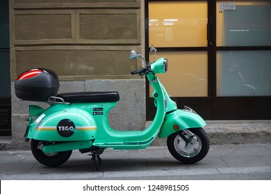 BARCELONA, SPAIN - NOVEMBER 29, 2018: Traditional italian scooter - Vespa on the sidewalk in Barcelona