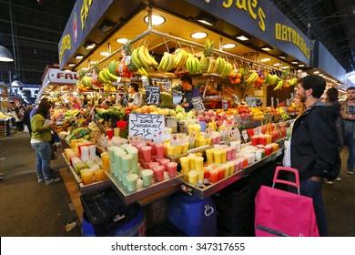 BARCELONA, SPAIN - OCT 17 2015 : People buying food inside Mercat de Sant Josep de la Boqueria. It is a large public market in the Ciutat Vella district of Barcelona