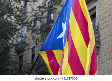 BARCELONA, SPAIN – OCTOBER 10, 2017: Catalan flag at the Arco de Trionfo, where Catalans are waiting for the Catalan President Carles Puigedemont's possible declaration of independence