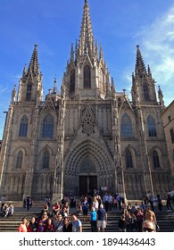 Barcelona, Spain - October 11, 2014: People taking pictures and mingling on the stairs in front of the Barcelona Cathedral in Catalonia Spain.