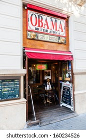 BARCELONA, SPAIN - OCTOBER 12: Irish Pub on October 12, 2013 in Barcelona. The name of the stylish pub is Obama British Africa with a figure of Barack Obama in the entrance.