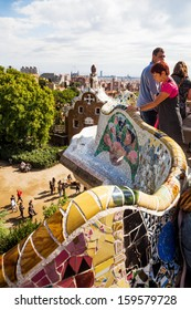 BARCELONA, SPAIN - OCTOBER 12: Park Guell with unidentified people on October 12, 2013 in Barcelona. The park together with other works of Antoni Gaudi  is listed on the UNESCO world heritage sites.