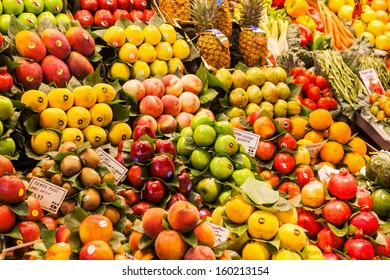 """BARCELONA, SPAIN - OCTOBER 14: in the market hall """"La Boqueria"""" on October 14, 2013 in Barcelona. The famous historical market hall has about 2.600 square meters and is a tourist attraction."""
