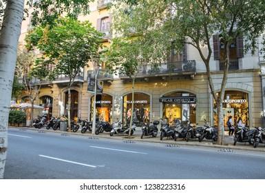 BARCELONA, SPAIN - OCTOBER 15, 2018: Busy Spanish streets in Barcelona. City life. Passeig de Gracia.
