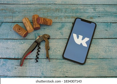 Barcelona, Spain - October 15, 2020; VK App with Wine Opener and Corks. VK is a Russian online social media and social networking service. #VK