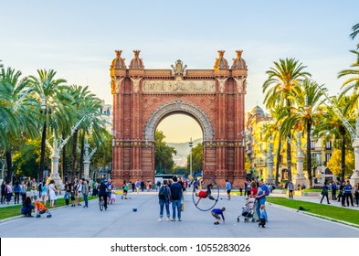 BARCELONA, SPAIN, OCTOBER 24,2014: People are strolling through an alley between the arch of triumph and ciutadella park Barcelona, Spain.