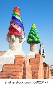 BARCELONA, SPAIN -OCTOBER 2:The mosaic chimneys made of broken ceramic tiles on roof of Palau Güell , one of the earlest Gaudi's  masterpieces, on October 02, 2011 in Barcelona, Spain