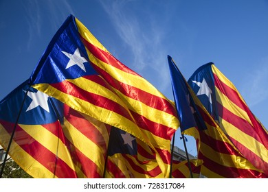 Barcelona, Spain - October 3, 2017. Demonstrators bearing catalan flags during protests for independence in Barcelona, Catalonia, Spain