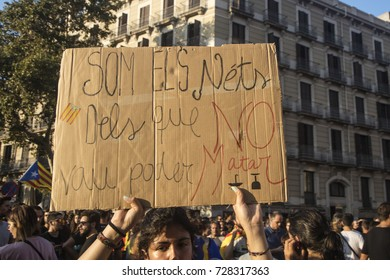 """Barcelona, Spain - October 3, 2017. Demonstrators bearing placards during protests in Barcelona. """"We are the grandsons of grandparents you could not kill (referring spanish civil war in 1936-39"""""""