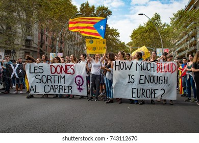 BARCELONA, SPAIN - OCTOBER 3, 2017: A contingent of young feminists carrying banners on the Ronda de Sant Pere to the huge peaceful pro-independence demonstration near the University of Barcelona.
