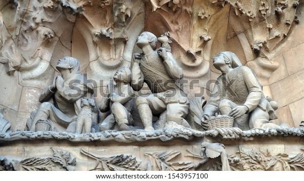 Barcelona / Spain - October 3, 2019: Statuary depicting scenes from the birth of Jesus carved into the front wall of Gaudi's Basilica de la Sagrada Familia in Barcelona, Spain.